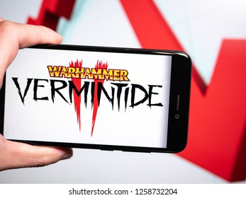 Murcia, Spain; Dic 14, 2018: Warhammer Vermintide II logo in phone with losses graphic on background. First person view