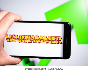 Murcia, Spain; Dic 14, 2018: Warhammer logo in phone with rises graphic on background. First person view