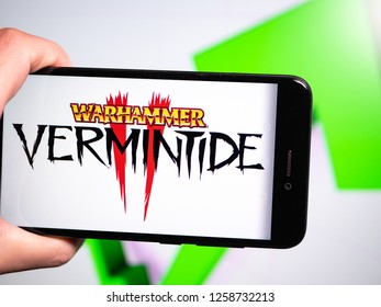 Murcia, Spain; Dic 14, 2018: Warhammer Vermintide II logo in phone with rises graphic on background. First person view