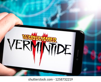 Murcia, Spain; Dic 14, 2018: Warhammer Vermintide II logo in phone with earnings graphic on background. Warhammer: Vermintide 2 is a first-person action video game