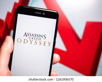 Murcia, Spain; Dic 17, 2018: Assassin's Creed Odyssey logo in phone with losses graphic on background. First person view
