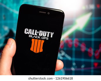 Murcia, Spain; Dic 17, 2018: Call of Duty Black Ops 4 logo in phone with earnings graphic on background. Call of Duty: Black Ops 4 is a multiplayer first-person shooter