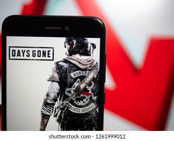 Murcia, Spain; Dic 17, 2018: Days Gone logo in phone with losses graphic on background. First person view
