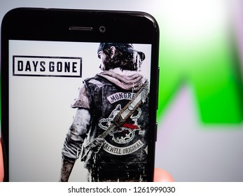 Murcia, Spain; Dic 17, 2018: Days Gone logo in phone with rises graphic on background. First person view