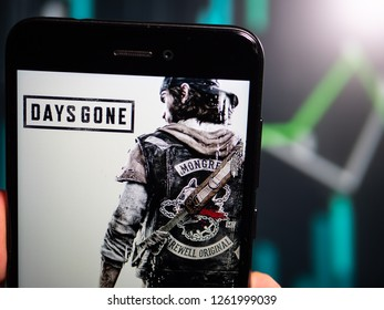 Murcia, Spain; Dic 17, 2018: Hand holding phone with Days Gone logo displayed in it with fluctuating graphic on background. First person view