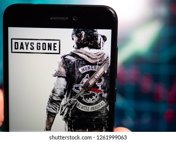 Murcia, Spain; Dic 17, 2018: Days Gone logo in phone with earnings graphic on background. Days Gone is an action-adventure game