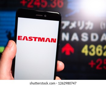 Murcia, Spain; Dic 17, 2018: Eastman Chemical Company logo in phone with New York stock exchange (NYSE) screen on background. First person view