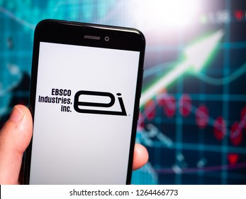Murcia, Spain; Dic 17, 2018: EBSCO Industries logo in phone with earnings graphic on background. EBSCO Industries is an American company