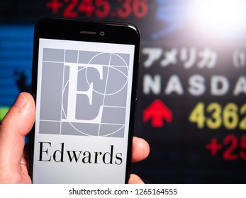 Murcia, Spain; Dic 17, 2018: Edwards Lifesciences logo in phone with New York stock exchange (NYSE) screen on background. First person view