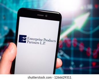 Murcia, Spain; Dic 17, 2018: Enterprise Products Partners logo in phone with earnings graphic on background. Enterprise Products Partners L.P. is an American midstream natural gas company
