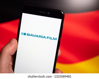 Murcia, Spain; Feb 25, 2019: Bavaria Film logo in phone with german flag on background. Bavaria Film is one of Europe's largest film production companies