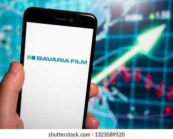 Murcia, Spain; Feb 25, 2019: Bavaria Film logo in phone with earnings graphic on background. Bavaria Film is one of Europe's largest film production companies