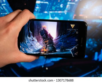 Murcia, Spain; Feb 7, 2019: Artifact logo in phone with esports tournament on background. Artifact is a digital collectible card game