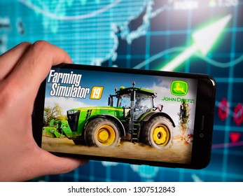 Murcia, Spain; Feb 7, 2019: Farming Simulator 19 logo in phone with earnings graphic on background. Farming Simulator 19 is a modern farmer simulator