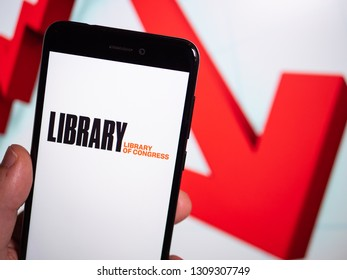 Murcia, Spain; Feb 8, 2019: Library of Congress (LOC) logo in phone with losses graphic on background. First person view