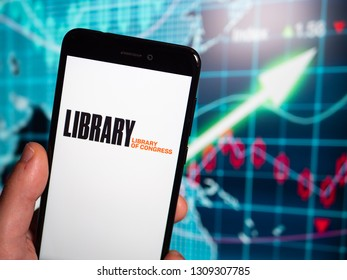 Murcia, Spain; Feb 8, 2019: Library of Congress (LOC) logo in phone with earnings graphic on background. Library of Congress is the research library that officially serves the United States Congress