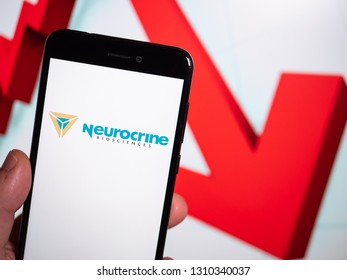 Murcia, Spain; Feb 8, 2019: Neurocrine Biosciences logo in phone with losses graphic on background. First person view