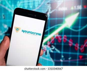 Murcia, Spain; Feb 8, 2019: Neurocrine Biosciences logo in phone with earnings graphic on background. Neurocrine Biosciences is a publicly traded biopharmaceutical company