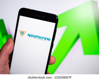 Murcia, Spain; Feb 8, 2019: Neurocrine Biosciences logo in phone with rises graphic on background. First person view