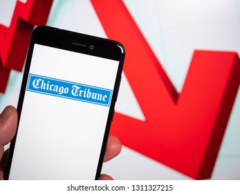 Murcia, Spain; Feb 8, 2019: Chicago Tribune logo in phone with losses graphic on background. First person view