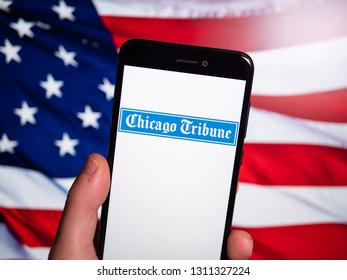 Murcia, Spain; Feb 8, 2019: Chicago Tribune logo in phone with United States flag on background. Chicago Tribune is a daily newspaper based in Chicago