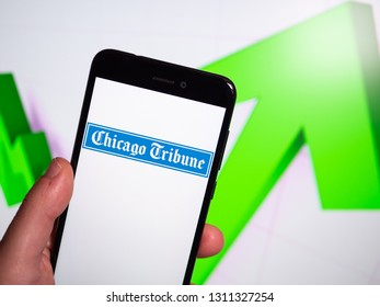 Murcia, Spain; Feb 8, 2019: Chicago Tribune logo in phone with rises graphic on background. First person view