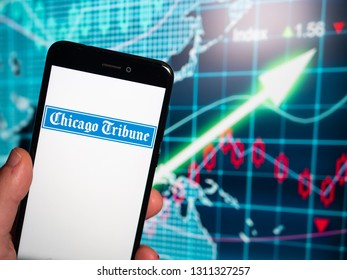 Murcia, Spain; Feb 8, 2019: Chicago Tribune logo in phone with earnings graphic on background. Chicago Tribunei s a daily newspaper based in Chicago