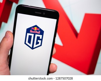 Murcia, Spain; Jan 16, 2019: Team OG logo in phone with losses graphic on background. First person view