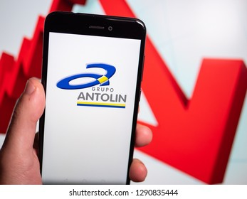 Murcia, Spain; Jan 17, 2019: Grupo Antolin logo in phone with losses graphic on background. First person view