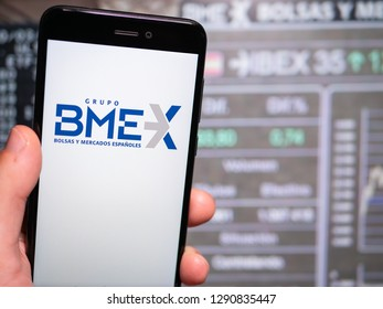 Murcia, Spain; Jan 17, 2019: Bolsas y Mercados Españoles (BME) logo in phone with stock exchange screen on background. First person view