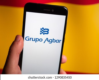 Murcia, Spain; Jan 17, 2019: Grupo Agbar logo in phone with spanish flag on background. Agbar is a Spanish company dedicated to services, distribution or treatment of water in Barcelona