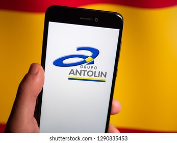 Murcia, Spain; Jan 17, 2019: Grupo Antolin logo in phone with spanish flag on background. Grupo Antolin is a spanish company that designs accessories for automotive