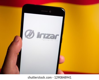Murcia, Spain; Jan 17, 2019: Irizar logo in phone with spanish flag on background. Irizar Group is a Spanish-based manufacturer of luxury bus and coach