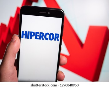 Murcia, Spain; Jan 17, 2019: Hipercor logo in phone with losses graphic on background. First person view