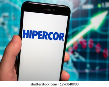 Murcia, Spain; Jan 17, 2019: Hipercor logo in phone with earnings graphic on background. Hipercor S.A. is an up-scale chain of hypermarkets in Spain