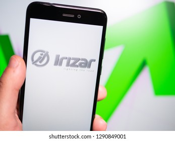Murcia, Spain; Jan 17, 2019: Irizar logo in phone with rises graphic on background. First person view