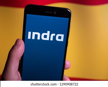 Murcia, Spain; Jan 17, 2019: Indra Sistemas blue logo in phone with spanish flag on background. Indra Sistemas is a Spanish information technology and defense systems company