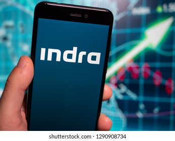 Murcia, Spain; Jan 17, 2019: Indra Sistemas blue logo in phone with earnings graphic on background. Indra Sistemas is a Spanish information technology and defense systems company