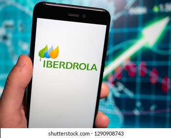 Murcia, Spain; Jan 17, 2019: Iberdrola logo in phone with earnings graphic on background. Iberdrola is a Spanish public multinational electric utility company