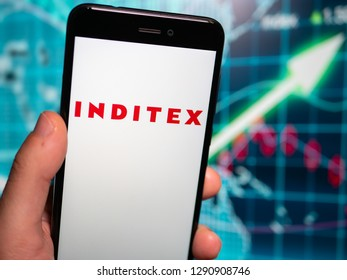 Murcia, Spain; Jan 17, 2019: Inditex logo in phone with earnings graphic on background. Inditex is a Spanish multinational clothing company
