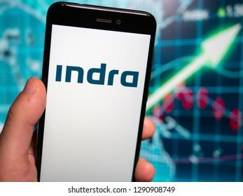 Murcia, Spain; Jan 17, 2019: Indra Sistemas white logo in phone with earnings graphic on background. Indra Sistemas is a Spanish information technology and defense systems company