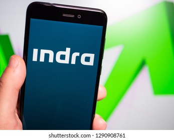 Murcia, Spain; Jan 17, 2019: Indra Sistemas blue logo in phone with rises graphic on background. First person view