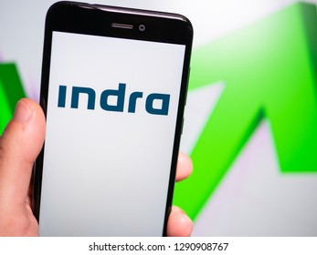 Murcia, Spain; Jan 17, 2019: Indra Sistemas white logo in phone with rises graphic on background. First person view