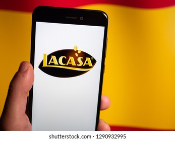 Murcia, Spain; Jan 17, 2019: Lacasa logo in phone with spanish flag on background. Lacasa S.A. is a Spanish confectionery company