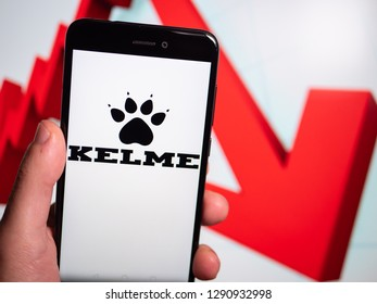 Murcia, Spain; Jan 17, 2019: Kelme logo in phone with losses graphic on background. First person view
