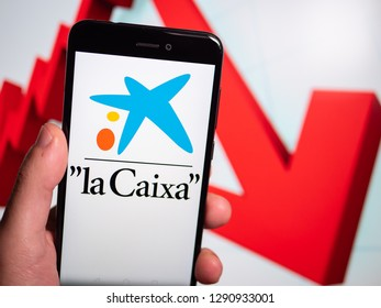 Murcia, Spain; Jan 17, 2019: La Caixa logo in phone with losses graphic on background. First person view