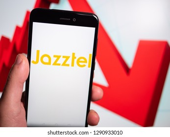 Murcia, Spain; Jan 17, 2019: Jazztel logo in phone with losses graphic on background. First person view