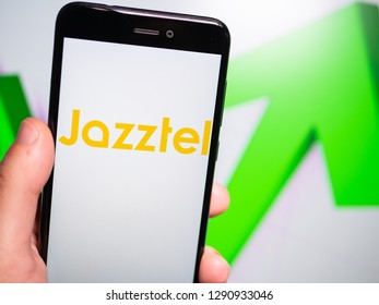 Murcia, Spain; Jan 17, 2019: Jazztel logo in phone with rises graphic on background. First person view