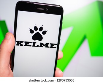 Murcia, Spain; Jan 17, 2019: Kelme logo in phone with rises graphic on background. First person view