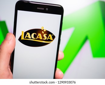 Murcia, Spain; Jan 17, 2019: Lacasa logo in phone with rises graphic on background. First person view